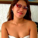 Filipina amateur poses all nude on her bed with just some sun glasses